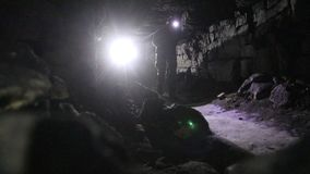 Travelers explore the dark cave stock footage