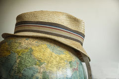 Travelers hat. On the globe Royalty Free Stock Photo