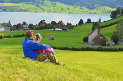 Travelers having rest on the hill Stock Photo