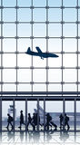 Travelers inside airport terminal. Royalty Free Stock Photos