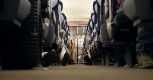 Travelers inside fast train. GERMANY - CIRCA 2016: Travel inside of fast European German ICE train with feet`s and shoes of passengers commuters stock footage