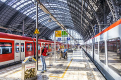 Travelers inside the Frankfurt central station heading or leavin Stock Photo