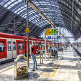 Travelers inside the Frankfurt central station heading or leavin Stock Photos