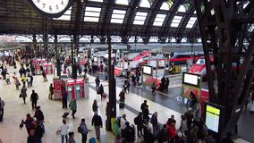 Travelers inside Milan railway station. People at MIlan railway station (Stazione di Milano Centrale) with handbags or suitcases before boarding stock video footage