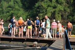 Travelers on Khwae river Stock Photo