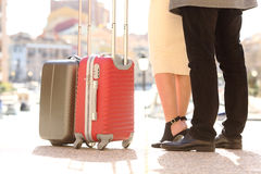 Travelers legs and suitcases in a travel location Stock Photos