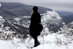 Travelers look at the beautiful scenic landscape of snowy mountains in winter stock photography