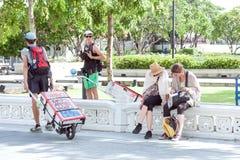 Travelers look a travel book at bangkok Stock Photos