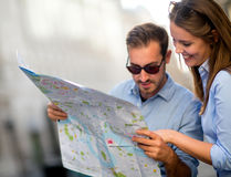 Travelers looking at a map Stock Photography