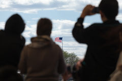 Travelers looking at the US flag Stock Photo