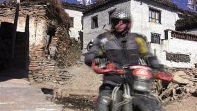 Travelers on motorcycles in the Tibetan village stock footage