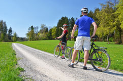 Travelers with mountain bikes Stock Images