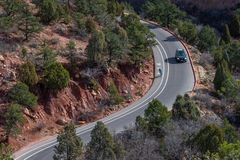 Travelers on mountain curvy highway road. Car driving on road around corner royalty free stock photography