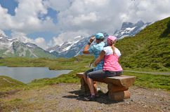 Travelers at a mountain lake Stock Image