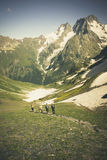 Travelers in the mountains. Mountain landscape and people. Royalty Free Stock Image