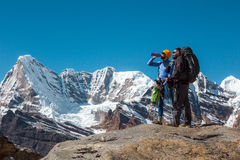 Travelers in Mountains relaxing and resting on Footpath Royalty Free Stock Photography