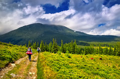 Travelers in the mountains Stock Photos
