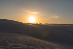 Travelers in north Brazil. Travelers walking over sunset sand dunes in Brazil Royalty Free Stock Photo