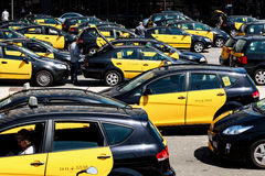 Travelers and numerous taxis Royalty Free Stock Photography