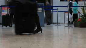 Travelers passengers in airport transit terminal walking with luggage baggage going traveling. stock video