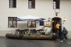 Travelers people walking go to inside of restaurant for dining dinner. At Pfunds village while evening time and raining on September 2, 2017 in Tyrol, Austria Stock Photography