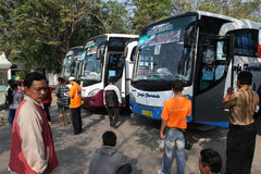 Travelers. Preparing to enter the bus after traveled historic sites in the city of Solo, Central Java, Indonesia Stock Image