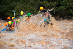 Travelers rafting with rubber boat Stock Photo