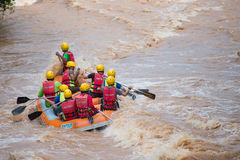 Travelers rafting with rubber boat Stock Image