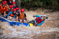 Travelers rafting with rubber boat Royalty Free Stock Images