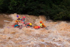 Travelers rafting with rubber boat Royalty Free Stock Image