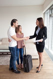 Travelers renting property, couple shaking hands with real estat Royalty Free Stock Photos