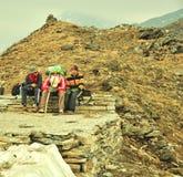 Travelers resting. While trekking their way to Skeleton lake in Himalayas region in Uttarakhand state in India royalty free stock image