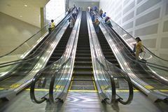 Travelers ride the escalator at the Deroit Airport, Detroit, Michigan Royalty Free Stock Photo