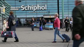 Travelers at Schiphol airport, Amsterdam stock video