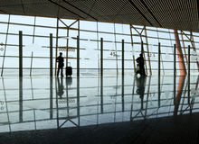 Travelers silhouettes at airport Stock Photography
