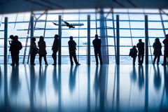 Travelers silhouettes at airport Royalty Free Stock Image