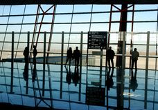 Travelers silhouettes at airport Stock Photo
