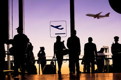 Travelers silhouettes at airport Stock Image