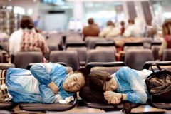 Travelers sleeping on a bench for relax waiting to transit. Stock Images