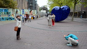 Travelers take a photograph in Delft, Netherlands, stock footage