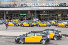 Travelers and taxis waiting in front of the railway station Barcelona-Sants in Barcelona, Spain royalty free stock photography
