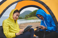 Travelers in tent Stock Image