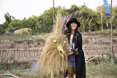 Travelers thai women people travel visit and posing portrait for take photo straw puppets or straws man figure Festiva. Travelers thai women people travel visit royalty free stock photography