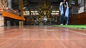 Travelers thai women travel visit and respect Su Tong Pae golden buddha