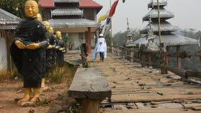 Travelers thai women walking on Su Tong Pae bamboo wooden bridge and travel