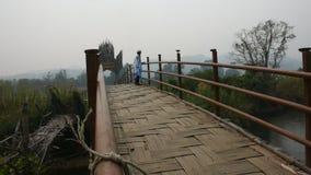 Travelers thai women walking travel visit on Su Tong Pae bamboo wooden bridge