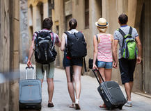 Travelers with travel bags walking Stock Photography