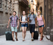 Travelers with travel bags walking Stock Images