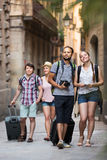 Travelers with travel bags walking Royalty Free Stock Photos