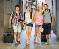 Travelers with travel bags walking Royalty Free Stock Images